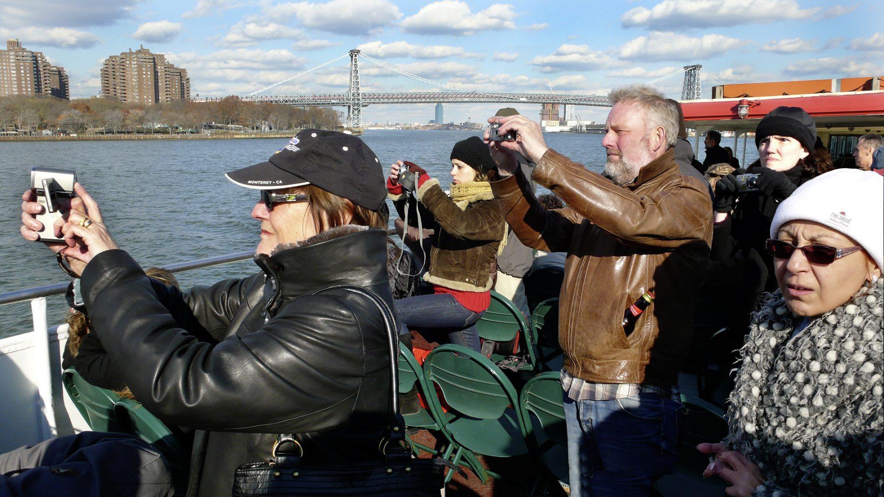 3 Fotografen vom boot
